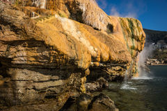 Scenic thermal waterfalls  on  beach in Loutro Edipsou, Evia, Gr Royalty Free Stock Photography