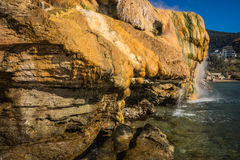 Scenic thermal waterfalls  on  beach in Loutro Edipsou, Evia, Gr Royalty Free Stock Image