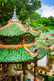 Scenic tile roofs with mosaic sculptures at the Linh Ung Pagoda Royalty Free Stock Images