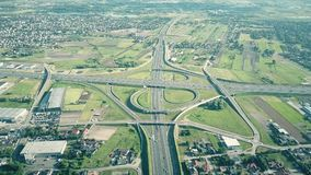 Scenic travelling aerial shot of big highway interchange in outskirts on a sunny summer day. Scenic travelling aerial shot of big highway interchange in Royalty Free Stock Photos