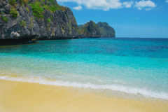 Scenic tropical beach, El Nido Palawan Philippines. Beautiful tropical beach. Scenic landscape with sandy beach sea and mountain island, El Nido, Palawan Royalty Free Stock Photography
