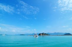Scenic tropical Malaysia and yacht in blue sea royalty free stock images