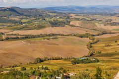 Landscape of San Quirico d`Orcia, Tuscany, Italy. Scenic Tuscan landscape with beautiful fields, meadows and hills. San Quirico d`Orcia, Tuscany, Italy Royalty Free Stock Photography