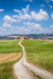 Scenic Tuscany landscape with farm house, Val d'Orcia, Italy Royalty Free Stock Images