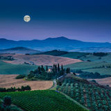 Scenic Tuscany landscape with rolling hills under full moon Stock Photography