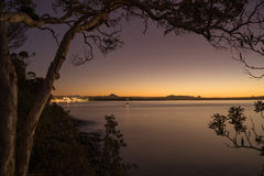 Scenic twilight beach view towards the city Stock Images