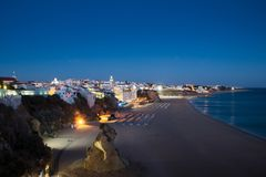 Scenic twilight evening view over the Praia dos Pescadores, Fishermen Beach in Albufeira, Algarve Portugal Royalty Free Stock Images