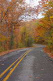 Scenic two lane road with curves in the Fall Stock Images