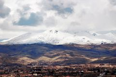 Scenic valley near Emmett, Idaho with snow capped mountains. Cloudy sky royalty free stock images