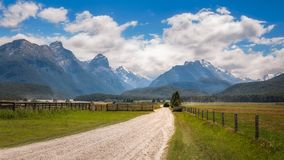 Snow-capped mountains in Mount Aspiring National Park, New Zealand. The scenic but very remote unsealed Glenorchy-Paradise road - View towards the mountain range Royalty Free Stock Image
