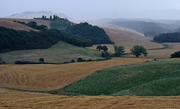 Scenic view of agricultural fields during a storm. Landscape of agricultural hills near Siena, tuscany, during a rainfall royalty free stock photos