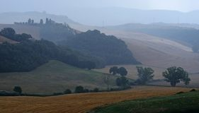 Scenic view of agricultural fields during a storm. Landscape of agricultural hills near Siena, tuscany, during a rainfall royalty free stock photography