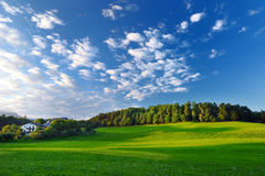 Scenic view of Alpine meadow located in South Tyrol, Renon/Ritten region, Italy. Beautiful cloudy sky above stock photos