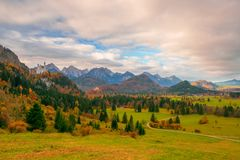 Scenic view of Alpine valley with Neuschwanstein and Hohenschwangau castles at autumn morning royalty free stock photography