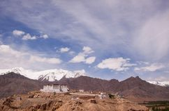 Scenic view on ancient buddhist monastery in himalayas with snowy mountains background. Region Ladakh. India. State Jammu and Kashmir Stock Photography