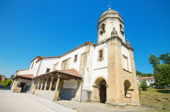 Scenic view of an ancient church in the touristic village of Lastres, Asturias, Spain Stock Image