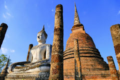Scenic View Ancient Meditating Buddha Statue and Grand Buddhist Stupa Ruins at Wat Sa Si in The Sukhothai Historical Park, Thailan Stock Photos