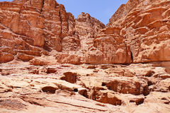 Scenic View Ancient Red Sandstone Mountain Behind Remains of Lawrence of Arabia`s House in Wadi Rum Desert, Jordan. Ancient Red Sandstone Mountain with Remains Royalty Free Stock Photos