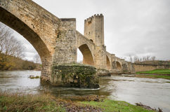 Scenic view of an ancient stone medieval bridge on a cloudy day in Frias, Castilla y Leon, Spain. Royalty Free Stock Image
