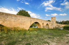 Scenic view of an ancient stone medieval bridge at dusk in Frias, Castilla y Leon, Spain. Royalty Free Stock Photography