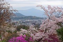 Arashiyama Through the Blossoms. A Scenic View of Arashiyama Through the Cherry Blossoms stock photo