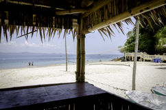 Scenic view from bamboo hut,beautiful tropical white sandy beach at sunny day. Stock Image
