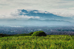 Bandung city. Scenic view of Bandung city with Mount Malabar volcano on background, West Java, Indonesia Royalty Free Stock Images