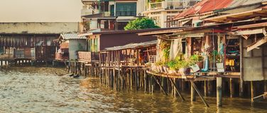 Scenic view of Bangkok riverside, Thailand. Panorama. Scenic view of Bangkok riverside, Thailand. Slums on stilts on the foreground. Panorama stock photos
