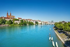 Basel waterfront seen from Wettstein bridge. Scenic view of Basel waterfront with Munster cathedral seen from Wettstein bridge Royalty Free Stock Photo