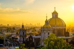 Scenic view at Basilica of Guadalupe with Mexico city skyline. At sunset, Mexico stock photo