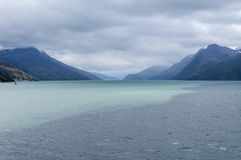 Scenic view of Beagle channel. Place inbetween Chile and Argentina where clear glacial water meets salted water from the ocean. Incredible natural phenomenon stock images