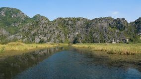 Scenic view of beautiful karst scenery and rice paddy fields. Scenic view of beautiful karst scenery, wetlands seen from the boat at Van Long Nature Reserve stock video footage