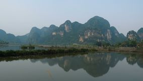 Scenic view of beautiful karst scenery, river and rice paddy fields stock footage