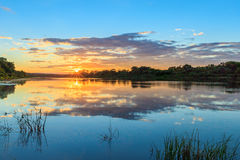 Scenic view of beautiful sunset above the river at summer Royalty Free Stock Images