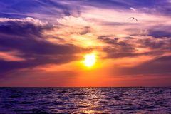 Scenic view of beautiful sunset above the sea Stock Photos