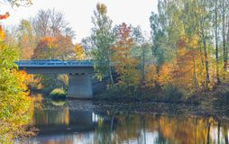 Scenic view of the bridge on reinforced concrete piers on a sunny autumn day stock photography