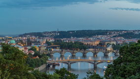Scenic view of bridges on the Vltava river day to night timelapse and of the historical center of Prague: buildings stock video footage