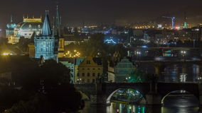 Scenic view of bridges on the Vltava river night timelapse and of the historical center of Prague: buildings stock video footage
