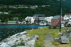 Scenic view of buildings on riverside with mountains on background. In Norway Royalty Free Stock Photos