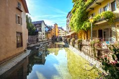 Scenic view on Canal du Thiou in Annecy. French Alps, France. Cityscape with scenic old buildings in Annecy. French Alps, France Royalty Free Stock Photos