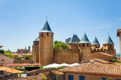 Scenic view of Carcassonne and Chateau Comtal. Scenic view of Cite de Carcassonne and Chateau Comtal against blue sky royalty free stock photo