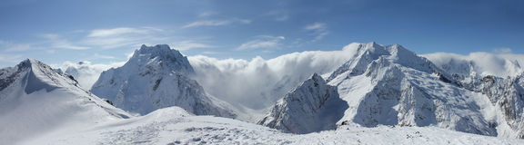 Scenic view of the Caucasus Mountains. Scenic view of Caucasus Mountains at Dombay Ski Resort, Russia Stock Photo