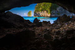Scenic view from a cave to azure lagoon tropical beach paradise. Bali. Indonesia Stock Photography