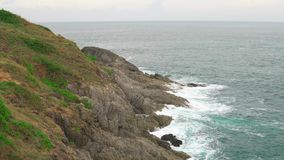 Scenic view of the cliff. The turquoise ocean surrounds a tropical island.  stock video