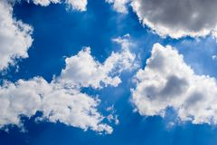 Clouds in the blue sky. Scenic view of clouds in the blue sky stock images