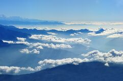 Scenic View of Clouds over Mountains Against Blue Sky Stock Images