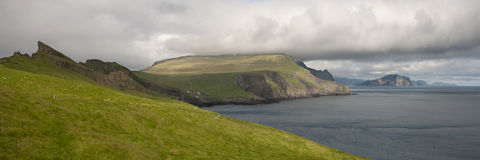 Scenic view of coast of Mykines Stock Photos