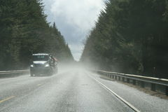 Scenic view of a coastal highway. Surrounded by fir trees, Oregon, U.S.A Royalty Free Stock Photography