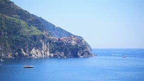View on architecture of old italian village and beautiful bay. Corniglia is one of the most popular old village in
