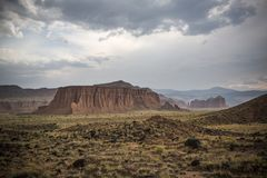 Scenic View of Desert Landscape Against Dramatic Sky Royalty Free Stock Images